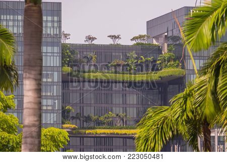 Singapore City, Singapore - 07 19 2015: Modern Glass Office Buildings With Green Trees In Singapore.