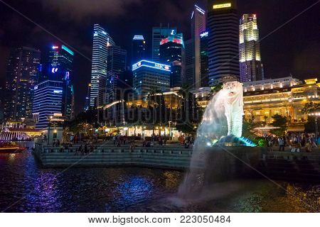 Singapore City, Singapore - 07 19 2015: Panoramic View Of Merlion Statue And Marina Bay Downtown Buildings In Singapore At Night.