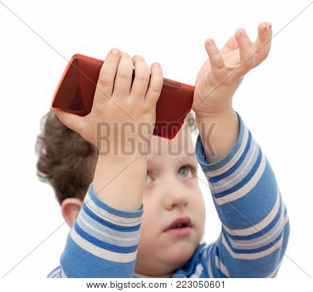 boy with the phone on a white background .