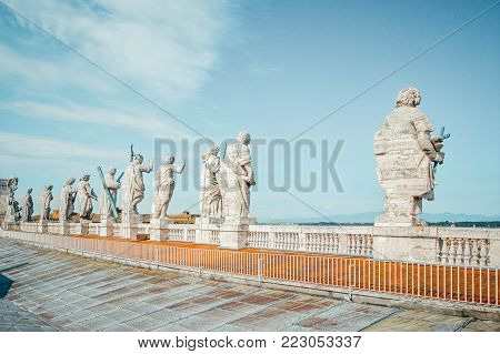Back view of eleven statues of the saints apostles on the top of St Peter Basilica roof,Vatican City, Rome, Italy
