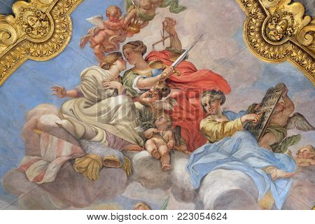 ROME, ITALY - SEPTEMBER 03: Fresco of virtues on the little cupola of side nave in Basilica dei Santi Ambrogio e Carlo al Corso, Rome, Italy on September 03, 2016.