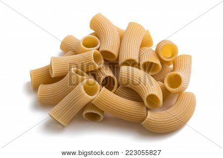 Spelt rigatoni pasta isolated on white background