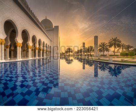 View of Sheikh Zayed Grand Mosque from water reflection at dusk, Abu-Dhabi, UAE