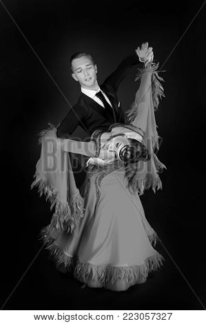 dance ballroom couple in a dance pose isolated on black background. sensual professional dancers dancing walz, tango, slowfox and quickstep. black and white