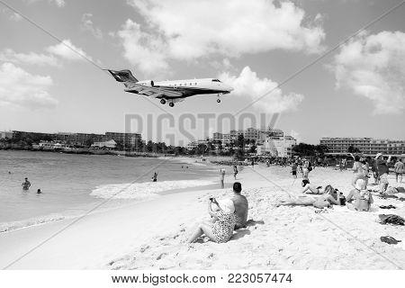 St.maarten, Kingdom Of Netherlands - February 13, 2016: Beach Crowds Observe Low Flying Airplanes La
