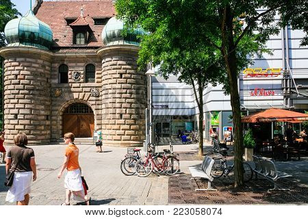 NUREMBERG, GERMANY - JULY 12, 2010: people on Hall platz square in Nurnberg city in summer day. Nuremberg is city in Bavaria state, it is Germany's fourteenth-largest city