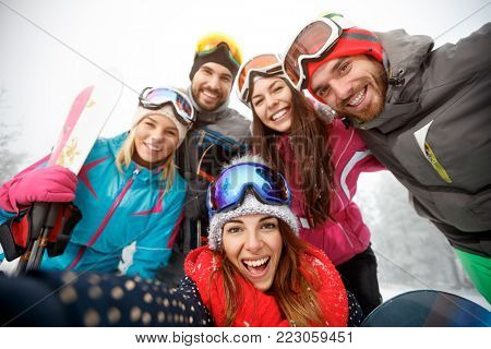 Happy group of  young skiers on skiing together