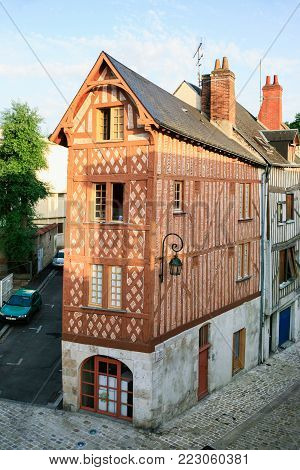 ORLEANS, FRANCE - JULY 9, 2010: medieval half-timbered residential house on street Rue de la Poterne in Orleans. Orleans is the capital of the Loiret department and of the Centre-Val de Loire region