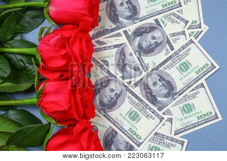 Pink roses with dollar bills instead of a gift. Template for March 8, Mother's Day, Valentine's Day