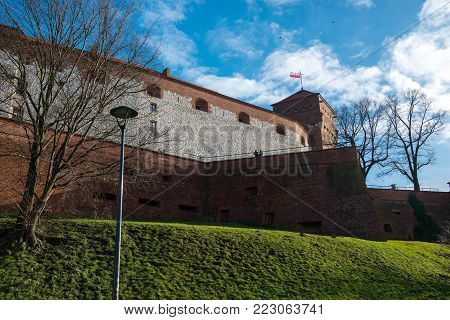 Viev of the ancient Wawel Royal castle in Krakow Poland on the background of blue sky.