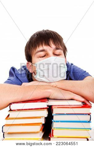 Sad and Sick Student in Flu Mask with the Books Isolated on the White Background