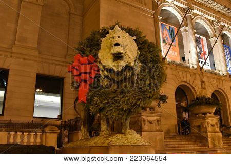 North Lion Statue adorned with a Christmas Wreath for the Holiday Season outside the Art Institute of Chicago, November 30, 2017, Chicago, IL
