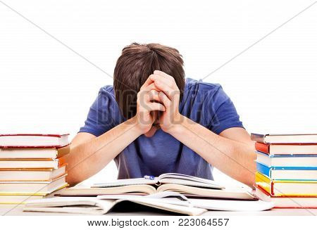 Tired and Troubled Student at the Writing Table on the White Background