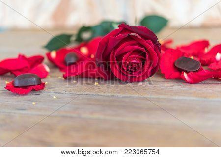 Red Rose Flower On Wooden Floor In Valentine's Day