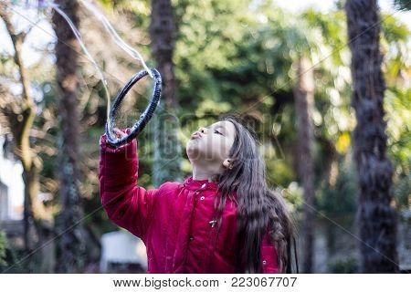 Child Makes Giant Soap Bubbles