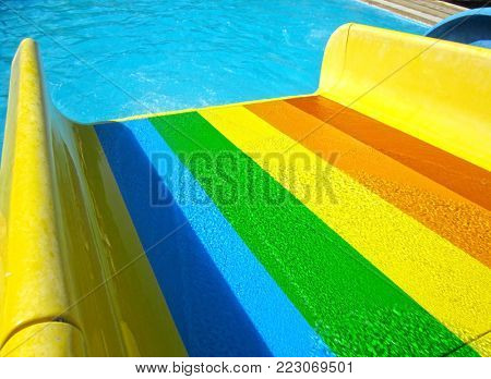 Colorful slider in water park background