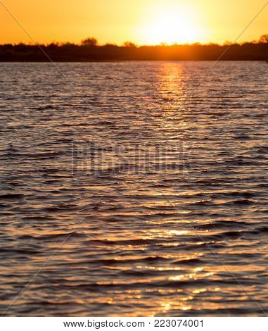 beautiful sunrise on the lake . Photo of an abstract texture