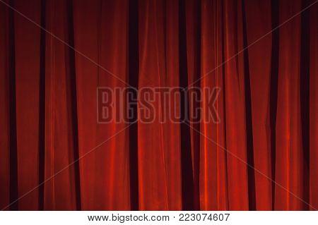 Wavy Red Velvet Curtain With Spot Illumination