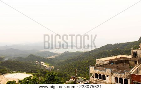 Scenic view of Jiufen old street ,Ruifang district with fog