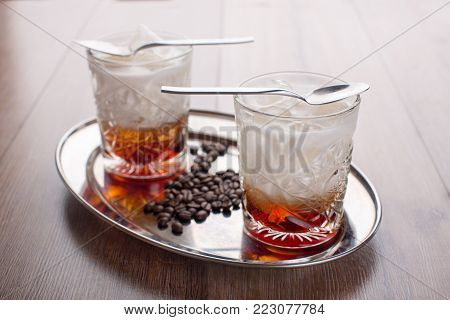 An invigorating coffee drink with grains on a tray