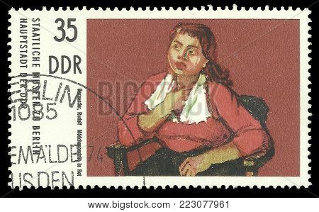 GDR - circa 1974: Stamp printed by GDR, Color edition on Art, shows Painting Girl's portrait in Red by Rudolf Borgartler, circa 1974