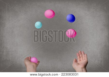 Female hands juggle colorful eggs. Food Concept