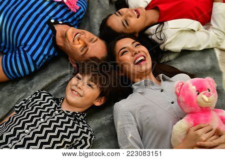 Family Concept. Family is happy in the house. Family is doing activities in the bedroom. The family loves each other happily.