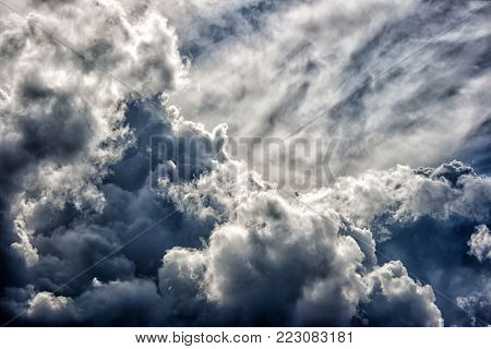 dark dense gloomy dramatic thundercloud on summer day