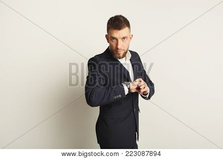 Handsome young caucasian businessman studio shot on white background. Confident serious man in formal clothes, copy space