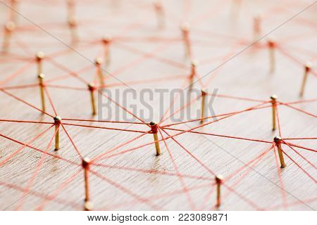 Linking entities. Network, networking, social media, internet communication abstract. Web of wires on wooden .