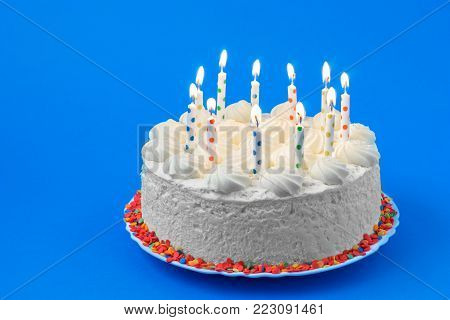 Birthday cake on a colored background, candles.
