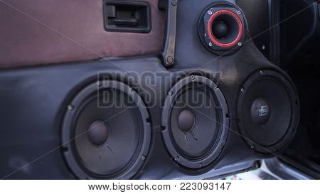 Car audio system close up honeycomb in front door panel, Car radio speaker. Music speakers in the doors of the car.