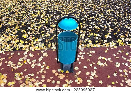 trash can trashcan dustbin garbage rubbish bin background waste round outside in street against brick wall with brick copy space residential classic old style copy space