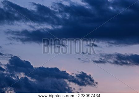 A dramatic and colorful cloudy sunset sky. Cloudy background.
