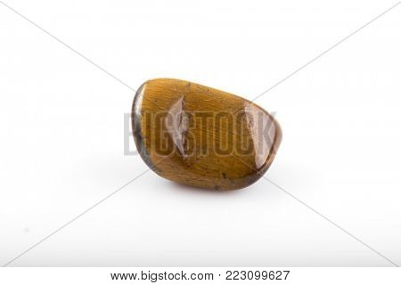 Tiger eye gem on white background.