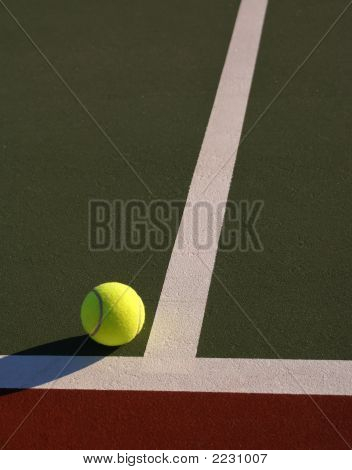 Tennis Ball On Line Closeup