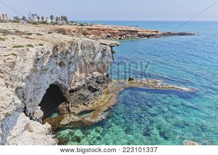 Shore near Monachus Monachus Arch. Cavo Greco cape. Ayia napa, Cyprus. Mediterranean sea landscape