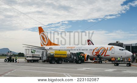 Santos Dumont Airport, Rio de Janeiro, Brazil - Dec 22, 2017: Airport workers at Rio de Janeiro's Santos Dumont Airport carry out duties on a Gol airliner airplane