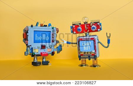 Chat bot robot welcomes android robotic character. Creative design toys on yellow background.