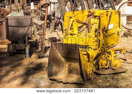 Vintage Yellow Mini Scoop Bucket Digger Used In Mining Operations