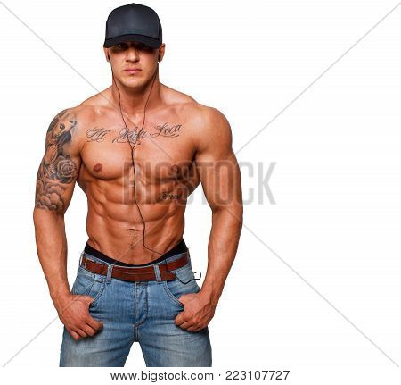 Image of fit topless man who is listening music from his mp3 player
