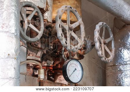 Steam pipe with a valve and manometer. Manometer pressure in the boiler room.