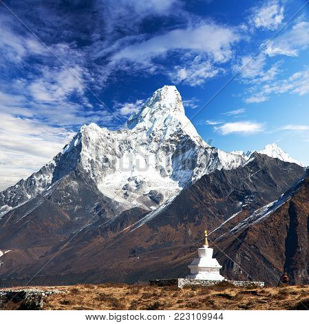 Mount Ama Dablam with stupa near Pangboche village and beautiful cloudy sky - way to mount Everest base camp - Khumbu valley - Nepal