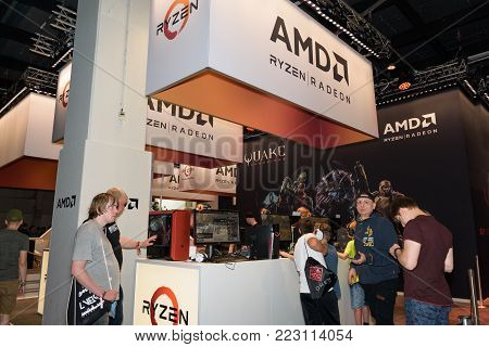 Cologne, Germany - August 24, 2017: Visitors at the booth of the processor and graphics card manufacturer AMD at Gamescom 2017. Gamescom is a trade fair for video games held annually at the Koelnmesse.