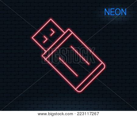 Neon light. USB flash drive line icon. Memory stick sign. Portable data storage symbol. Glowing graphic design. Brick wall. Vector