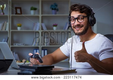Young man playing games long hours late in the office