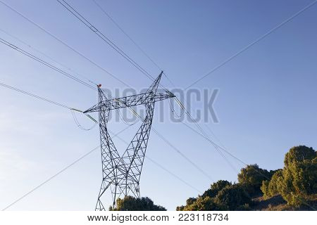 High-voltage power lines. Electricity distribution in La Rioja, Spain. The meadow below. Industry and nature coexist.