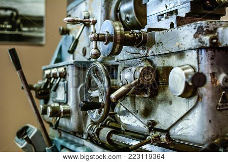 Old lathe machine full of manual knobs and mechanism poster