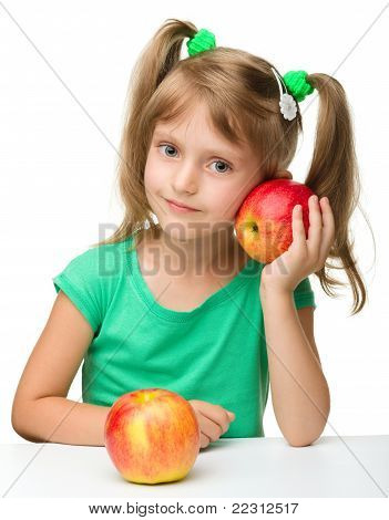 Portrait Of A Little Girl With Two Apples