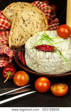 Domestic mature mold cheese. Dairy product. Aromatic cheese with mold